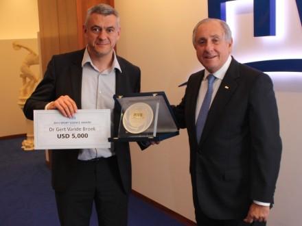 Dr. Gert Vande Broek with FIVB President Dr. Ary S. Graça F