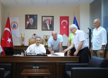 Ozbey signing contract